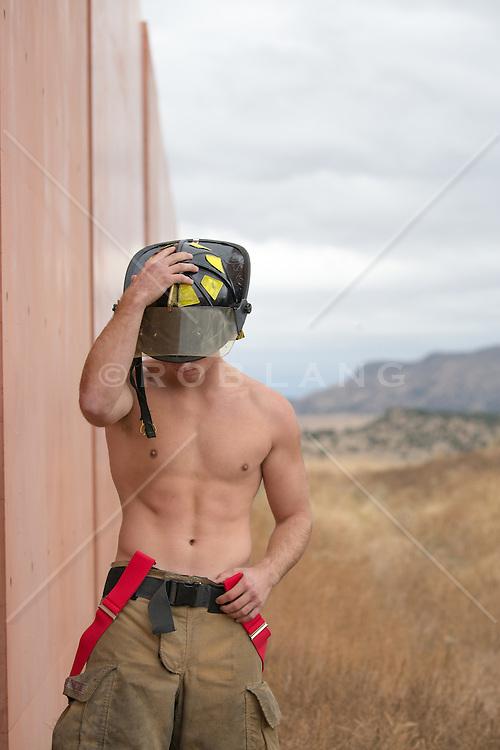shirtless hunky muscular fireman without a shirt outdoors