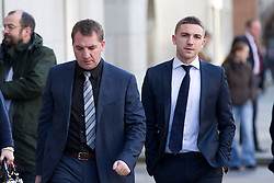 © Licensed to London News Pictures. 07/02/2013. London, UK. Brighton and Hove Albion football player Anton Rodgers, 20, (R) is seen arriving at the Old Bailey with his father, Liverpool football club manager Brendan Rodgers, in London today (07/02/13) where he (Anton) and four other players are facing charges of sexual assault. Photo credit: Matt Cetti-Roberts/LNP