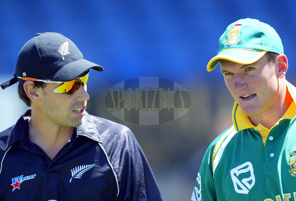 13 February 2004, International one day cricket, Eden Park, Auckland, New Zealand. Match 1 in series of 6, New Zealand vs South Africa..Stephen Fleming and Graeme Smith..Pic: Andrew Cornaga/Photosport