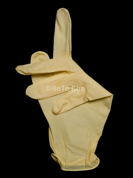 rubber glove with an attention asking gesture