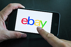 eBay online auction app logo on screen of iPhone 6 Plus smart phone