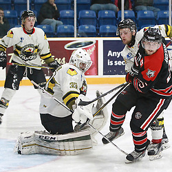 "TRENTON, ON  - MAY 5,  2017: Canadian Junior Hockey League, Central Canadian Jr. ""A"" Championship. The Dudley Hewitt Cup. Game 7 between Georgetown Raiders and the Powassan Voodoos.  Nate McDonald #33 of the Powassan Voodoos makes the save as Jordan Anderson #25 of the Georgetown Raiders drives to the net during the third period.<br /> (Photo by Tim Bates / OJHL Images)"
