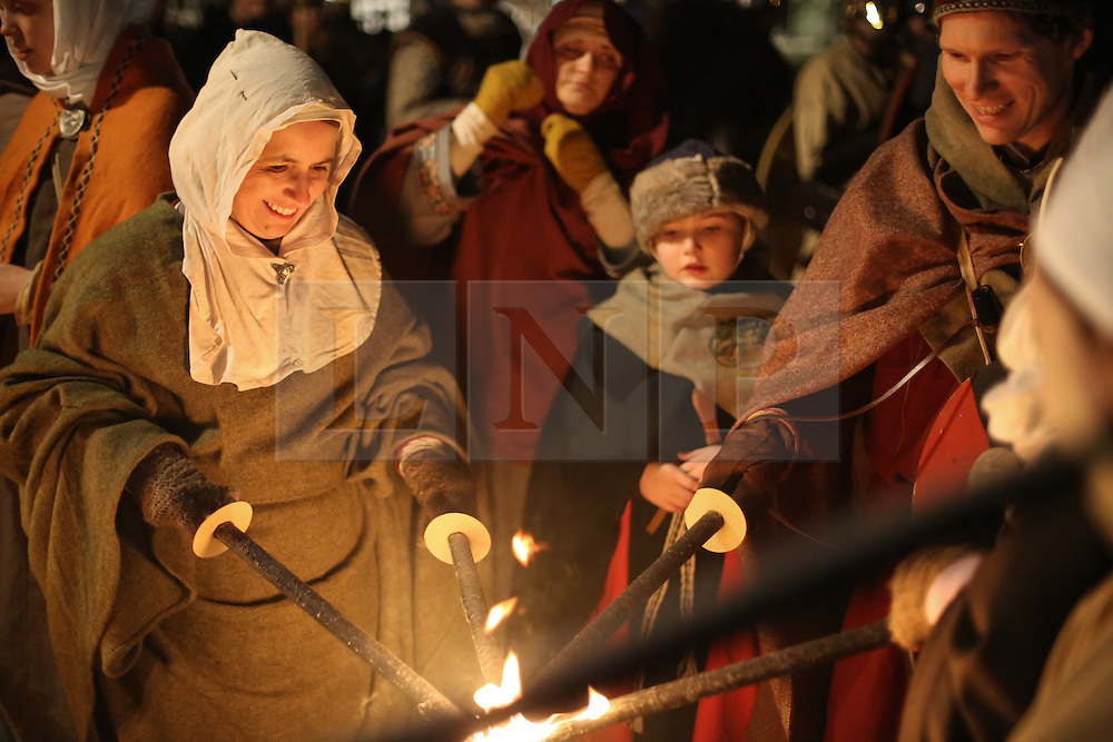 © Licensed to London News Pictures. 20/02/2016. York, UK. Vikings light their torches during the finale of the annual Jorvik Viking Festival in York, North Yorkshire. The historic city was transformed into a fiery battleground as this year's end to the week long festival told the story of the infamous Battle of Assundun. The festival, which is run by the Jorvik Viking Centre, takes place every February in tradition of an ancient Viking festival known as Jolablot.  Photo credit : Ian Hinchliffe/LNP