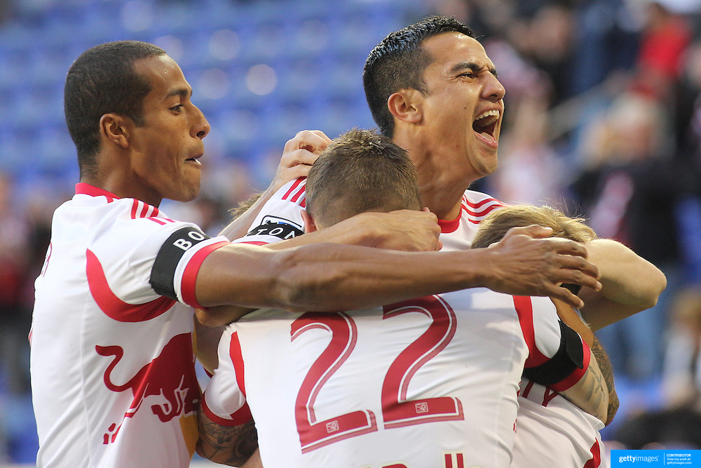 Tim Cahill, (top), New York Red Bulls, celebrates a goal by Dax McCarty, (hidden) along with team mate Jonny Steele and Roy Miller, (left), during the New York Red Bulls V New England Revolution, Major League Soccer regular season match at Red Bull Arena, Harrison, New Jersey. USA. 20th April 2013. Photo Tim Clayton
