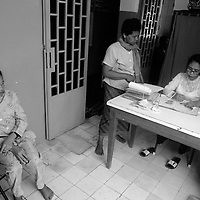 "SIEM REAP, FEBRUARY-28 : patients register for  group therapy in the Siam Reap mental hospital..The counselors and doctors hope to reach mor people through education.. .The country's entire infrastructure, including the health system, was destroyed during the Khmer Rouge reign and years of civil war. Only in recent years , several non governmental organizations have helped provide mental health services and training in the country in collaboration with local healers..Mental health service is relatively new to Cambodia, but much needed. Before the Pol Pot regime Cambodia only had one mental hospital for the whole population which was destroyed during the years of horror..Modest by western standards, the first mental health clinic for all of Cambodia was set up in Siem Reap by a team from Harvard University in 1994. .This is because many refugees settled down in and around Siem Reap. 102 doctors and counsellers were trained by the Harvard specialists in the late nineties as more than 80 percent of the population was traumatized by the Pol Pot years, and even more during their years in the refugee camps. Studies have shown that most  Cambodians showed PTSD ( Posttraumatic Stress Disorder) symptoms similiar to the Jewish survivors of concentration camps. . .As for the future, Cambodians are sceptical if there'd be a fair trial for the people . It'd be very difficult to bring patients to the capital Phnom Penh to witness . Due to Cambodias underdevelopped infrastructure, many Cambodians are even not aware of the trial preparations. There's no money and also many people do not want to be reminded. says a counselor in Siem Reap:""  it only would open old wounds. People rather suffer in silence"".."