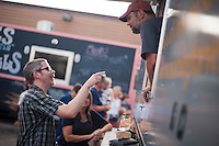 Customers visit the food trucks at The Little Fleet for the cusine and the social space it creates.