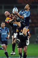 Brendon Leonard and Luke McAlister collide midair. Investec Super Rugby - Chiefs v Blues, Waikato Stadium, Hamilton, New Zealand. Saturday 26 March 2011. Photo: Andrew Cornaga / photosport.co.nz