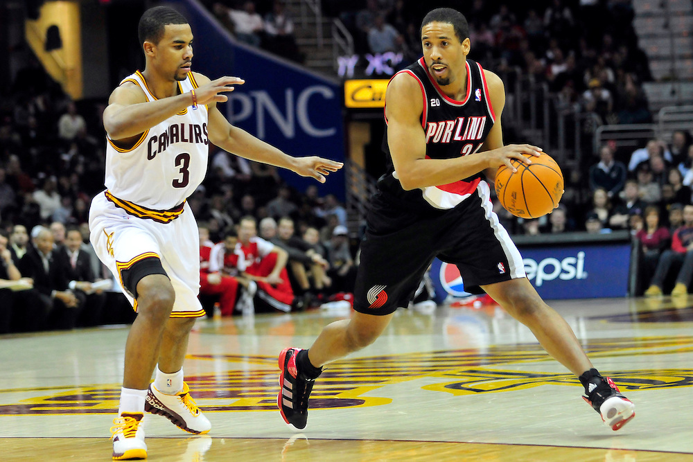 Feb. 5, 2011; Cleveland, OH, USA; Cleveland Cavaliers point guard Ramon Sessions (3) tries to stop Portland Trail Blazers point guard Andre Miller (24) during the fourth quarter at Quicken Loans Arena. The Trail Blazers beat the Cavaliers 111-105. Mandatory Credit: Jason Miller-US PRESSWIRE