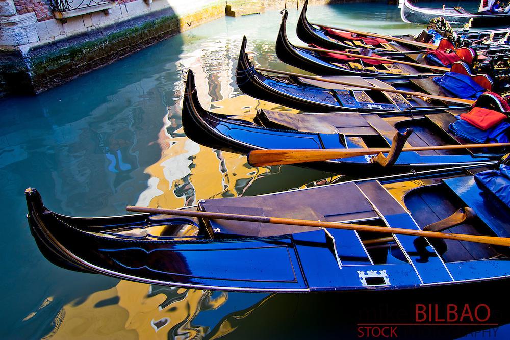 Gondolas in a canal. Venice, Italy.