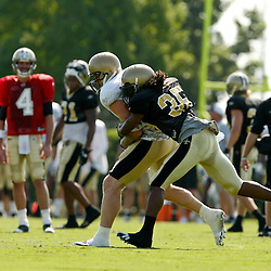 July 31, 2010; Metairie, LA, USA; New Orleans Saints tight end Jeremy Shockey (88) catches a pass in front of cornerback Reggie Jones (35) during a training camp practice at the New Orleans Saints practice facility. Mandatory Credit: Derick E. Hingle