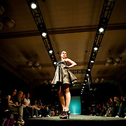 April 8, 2011 - Bronx, NY : A student model walks the catwalk during the Manhattan College En Vogue charity fashion show on April 8. The show, organized by the college's Fashion Student Association, raised money for Autusm Speaks, an advocacy organization that sponsors autism research and conducts awareness and outreach activities. Karsten Moran / The Riverdale Press