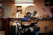 WASHINGTON DC--11/2/96--Archie Edwards, 78, is a treasure in American folk culture. He has played his style of Country Blues all over the world. He has owned a barbershop in Northeast DC since 1959, where he hosts impromptu jam sessions when he is in town....by ANDRE F. CHUNG/Sun Staff