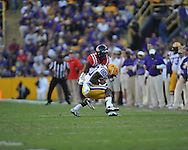 LSU wide receiver Jarvis Landry (80) is tackled by Ole Miss defensive back Mike Hilton (28) at Tiger Stadium in Baton Rouge, La. on Saturday, November 17, 2012.....