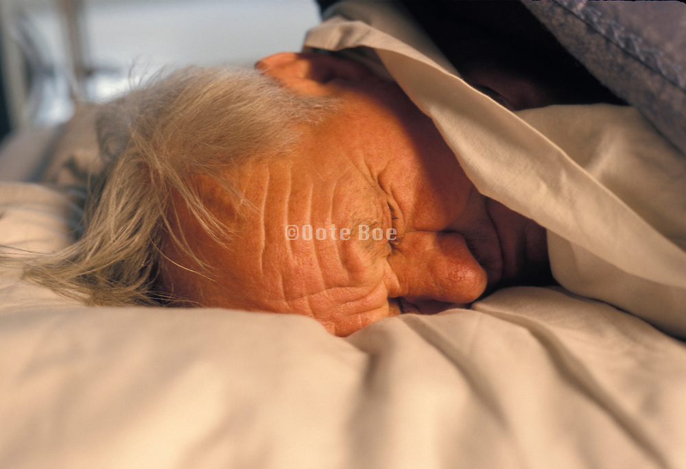 close up of an elderly man while sleeping during daytime