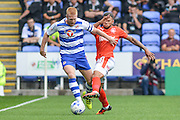 Reading FC defender (5) Paul McShane and Huddersfield Town striker (21) Nahki Wells during the EFL Sky Bet Championship match between Reading and Huddersfield Town at the Madejski Stadium, Reading, England on 24 September 2016. Photo by Mark Davies.