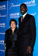 Caryl Stern and Dikembe Mutombo pose at the 2009 UNICEF Snowflake Ball Arrivals in New York City on December 2, 2009.