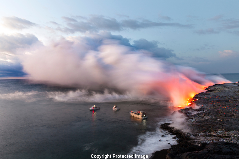 HI00338-00...HAWAI'I -Boats approaching lava flowing into the Pacific Ocean from the East Riff Zoneof the Kilauea Volcano on the Island of Hawai'i.