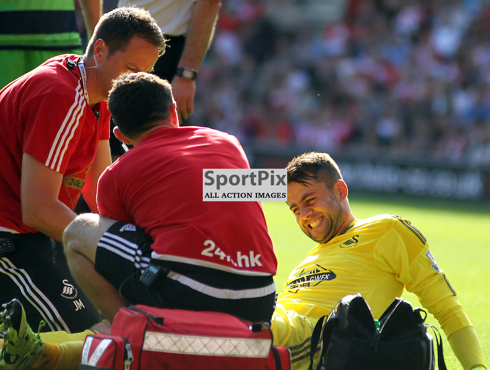 Lukasz Fabianski grimaces in pain whilst receiving treatment  During Southampton vs Swansea on Saturday 26th September 2015.