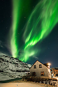 Small village of Hof with northern lights above, Iceland