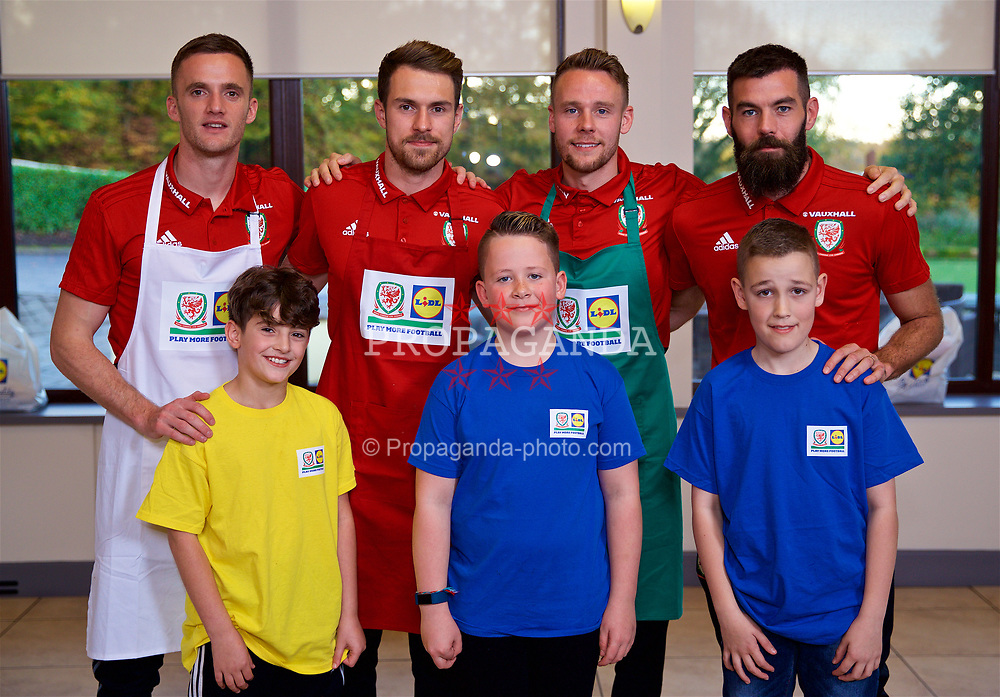 CARDIFF, WALES - Tuesday, November 7, 2017: Wales' Andy King, Aaron Ramsey, Chris Gunter and Joe Ledley with the judges after a Lidl sponsored Cook-off at the La Cuchina Restaurant at the Vale Resort ahead of the international friendly match against France. (Pic by David Rawcliffe/Propaganda)