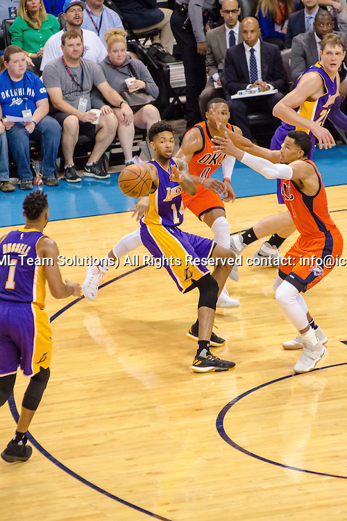 OKLAHOMA CITY, OK - OCTOBER 30:  Los Angeles Lakers Forward Brandon Ingram (14) passes the ball to Los Angeles Lakers Guard D'Angelo Russell (1) versus Oklahoma City Thunder.  October 30, 2016, at the Chesapeake Energy Arena Oklahoma City, OK. (Photo by Torrey Purvey/Icon Sportswire)