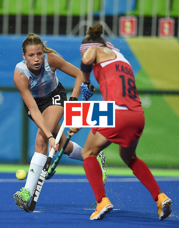 Argentina's Delfina Merino (L) fights for the ball with the USA's Michelle Kasold during the women's field hockey Argentina vs USA match of the Rio 2016 Olympics Games at the Olympic Hockey Centre in Rio de Janeiro on August, 6 2016. / AFP / MANAN VATSYAYANA        (Photo credit should read MANAN VATSYAYANA/AFP/Getty Images)