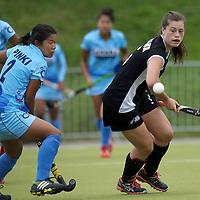 MONCHENGLADBACH - Junior World Cup<br /> Pool C: New Zealand - India<br /> photo: Pinky Devi Thokchom (blue) and Sian Fremaux (black).<br /> COPYRIGHT FRANK UIJLENBROEK FFU PRESS AGENCY