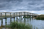 Wooden footbridge walkway at Ridgevale Beach, Nantucket Sound, Cape Cod, New England, USA