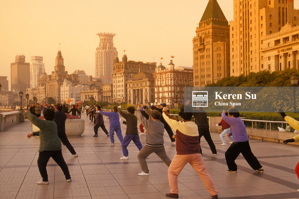 People practicing Taichi on the Bund in early morning, Shanghai, China