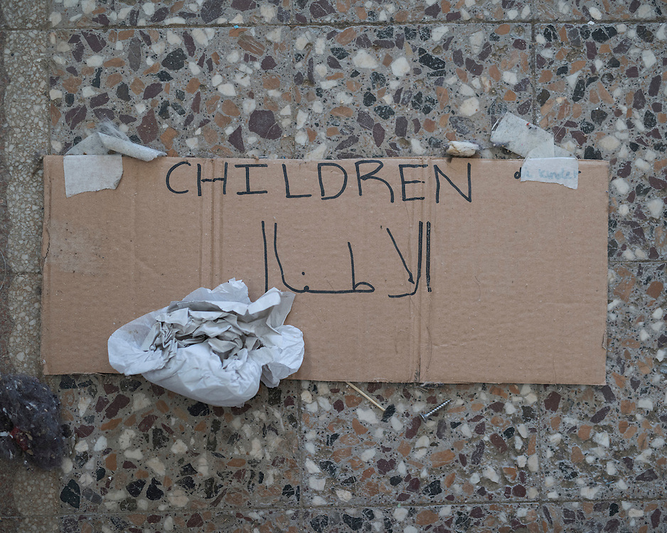 A sign reads 'children' in English and Arabic at the former refugee camp in the port of Lakki. <br />