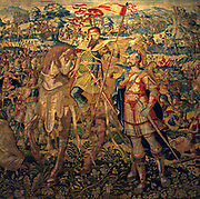 Godefroy de Bouillon.  Similar in design to the King David tapestry, this shows the crusader Godefroy de Bouillon as a victorious soldier.  Godefroy captured Jerusalem in 1099.  The heroic stories in both tapestries are depicted in a traditional manner, which adds to their magnificence. The naturalistic details in the borders are more up to date in style.  The weaver's monogram and the mark of the city of Brussels appear in the lower borders. Tapestry, between 1610-1631