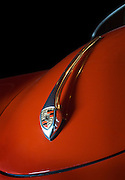 Image of an Orange 1950's Porsche Speedster in the studio, Seattle, Washington, Pacific Northwest