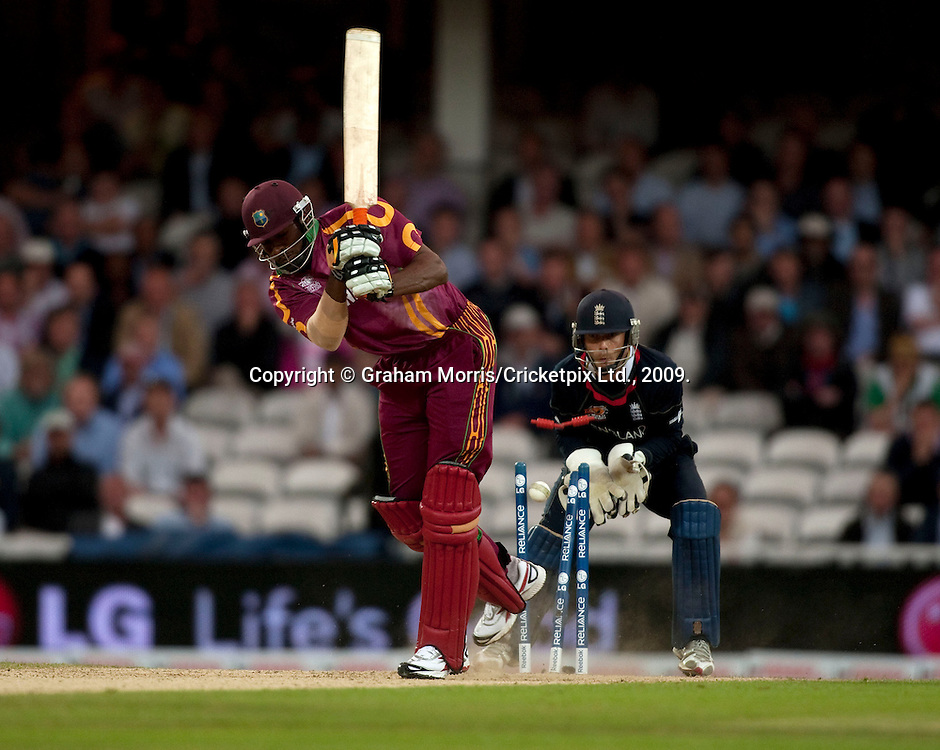 Kieron Pollard is bowled by Adil Rashid during the ICC World Twenty20 Cup match between West Indies and England at The Oval. Photo © Graham Morris (Tel: +44(0)20 8969 4192 Email: sales@cricketpix.com)