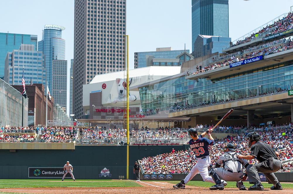 Justin Morneau #33 of the Minnesota Twins connects for his first home run of two against the New York Yankees on July 4, 2013 at Target Field in Minneapolis, Minnesota.  The Yankees defeated the Twins 9 to 5.  Photo by Ben Krause