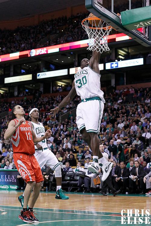 06 March 2012: Boston Celtics power forward Brandon Bass (30) dunks the ball on a fast break during the Boston Celtics 97-92 (OT) victory over the Houston Rockets at the TD Garden, Boston, Massachusetts, USA.