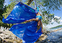 Erin Lovett Sherman performs on aerial silks on Lake Winnipesaukee during her artist in residence with Sandy Island Family Camp.    (Karen Bobotas/for the Laconia Daily Sun)