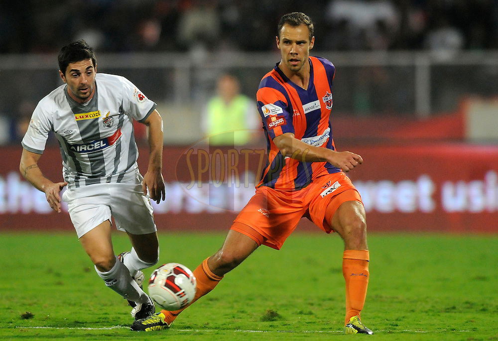 Joffre Mateu Gonzalez of Atletico de Kolkata and Krisztian Vadocz of Pune City during match 44 of the Hero Indian Super League between FC Pune City and Atletico de Kolkata FC held at the Shree Shiv Chhatrapati Sports Complex Stadium, Pune, India on the 29th November 2014.<br /> <br /> Photo by:  Pal Pillai/ ISL/ SPORTZPICS