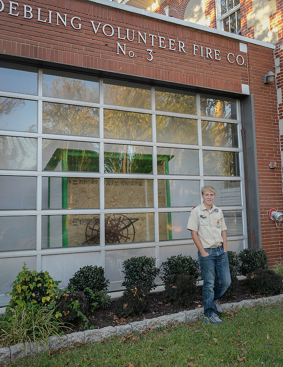 William Blakeslee, a Florence Township Memorial High School senior, stand with the  historic fire sheds, that he recreated, that were common in the village of Roebling before the days of fire trucks. The shed is photographed here on display at Roebling auditorium.  on Monday, September 23, 2013 in Roebling, Florence Twp, NJ
