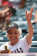 ANAHEIM, CA - JULY 20:  A female fan smiles and waves during the Los Angeles Angels of Anaheim game against the Seattle Mariners at Angel Stadium on Sunday, July 20, 2014 in Anaheim, California. The Angels won the game 6-5. (Photo by Paul Spinelli/MLB Photos via Getty Images)