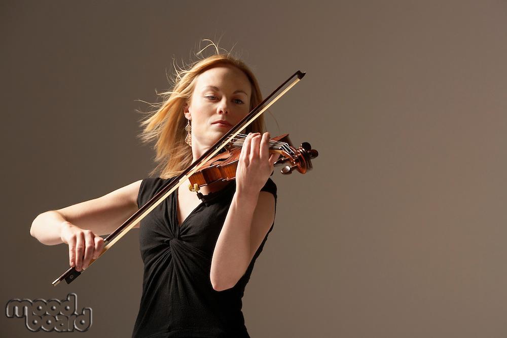 Woman Playing Violin with windblown hair