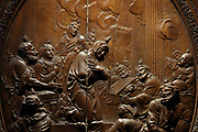 Descent of the Holy Spirit on the Apostles and Mary, Pentcost, detail, bas-relief in a medallion on the sculpted wooden choir stalls, of which 78 of 114 remain, 52 upper and 26 lower stalls, carved by Jean Noel and Louis Marteau after drawings by Rene Charpentier and Jean Dugoulon, early 18th century, in the choir of the Cathedrale Notre-Dame de Paris, or Notre-Dame cathedral, built 1163-1345 in French Gothic style, on the Ile de la Cite in the 4th arrondissement of Paris, France. The high backs of the stalls are decorated with bas-reliefs and separated by trumeaux decorated with foliage and instruments of the Passion. Photographed on 17th December 2018 by Manuel Cohen