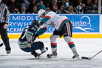KELOWNA, CANADA - APRIL 3: Ryan Olsen #27 of the Kelowna Rockets checks Russell Maxwell #37 of the Seattle Thunderbirds to the ice on April 3, 2014 during Game 1 of the second round of WHL Playoffs at Prospera Place in Kelowna, British Columbia, Canada.   (Photo by Marissa Baecker/Getty Images)  *** Local Caption *** Ryan Olsen; Russell Maxwell;