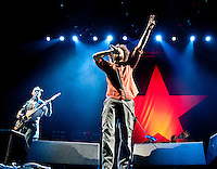 Tim Commerford, Zack de La Rocha, Brad Wilk  of Rage Against the Machine performs the L.A. Rising Festival at L.A. Coliseum July 30, 2011