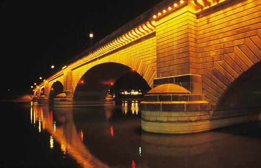 View of London Bridge lit at Night on Lake Havasu in Arizona.