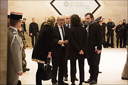A man who attempted a knife attack on soldiers guarding the Louvre Museum in Paris was shot and injured. French Interior Minister Bruno le Roux, center left, Defense Minister Jean-Yves le Drian and Culture Minister Audrey Azoulay inside the Louvre Museum after a shooting outside at the museum in Paris, on February 3, 2017. Photo by Frederic Lafargue/ABACAPRESS.COM