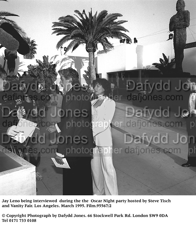 Jay Leno being interviewed  during the the  Oscar Night party hosted by Steve Tisch and Vanity Fair. Los Angeles. March 1995. Film.95567/2<br />