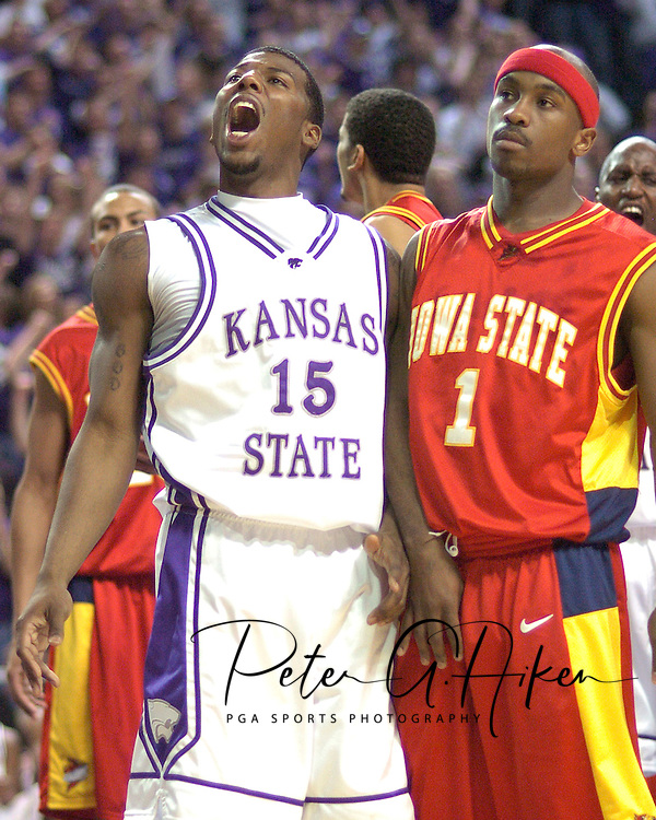 Kansas State's David Hoskins (L) reacts after scoring over Iowa State's Curtis Stinson (R) in the second half at Bramlage Coliseum in Manhattan, Kansas, February 8, 2006.  K-State defeated the Cyclones 66-63.