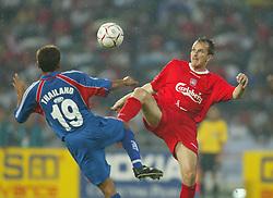 BANGKOK, THAILAND - Thailand. Thursday, July 24, 2003: Liverpool's Dietmar Hamann and Thailand's Somjet Satabud during a preseason friendly match at the Rajamangala National Stadium. (Pic by David Rawcliffe/Propaganda)