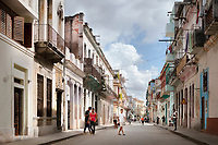 Streetscape in Old Havana, with four men in the foreground.