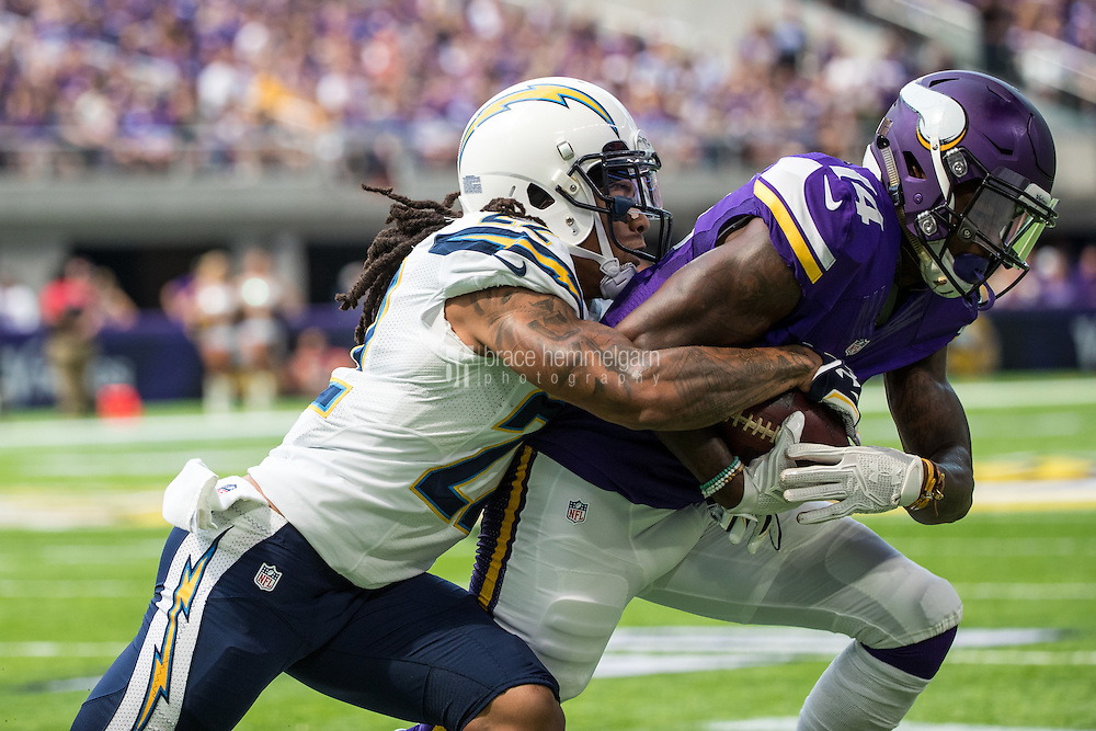 Aug 28, 2016; Minneapolis, MN, USA; Minnesota Vikings wide receiver Stefon Diggs (14) is tackled by San Diego Chargers cornerback Jason Verrett (22) during a preseason game at U.S. Bank Stadium. The Vikings defeated the Chargers 23-10. Mandatory Credit: Brace Hemmelgarn-USA TODAY Sports